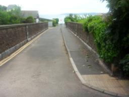 Turn right over the railway bridge