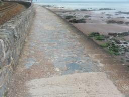 The surface changes. BEWARE, this surface can be very slippery during and after wet weather. There is a drop of 5 metres to the beach and sea with no barriers.