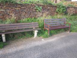 Seats are spaced along the path at regular intervals.