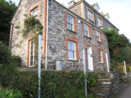 Halfway up the hill  is the house used by Doc Martin as a surgery. The house is owned privately.