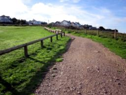The car park overlooking Polzeath Beach is reached by turning left at the signpost on the hill descending towards Polzeath beach from Rock. Fee payable.