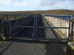 Gate giving access to Dam wall. Open the gate requires lifting a heavy metal latch set at 1220mm (48 ins) above ground level