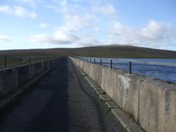 Route across Dam 310m long and 2.5m wide. Wall is approx 960mm high with a bar at 1200mm( 47 ins) above 