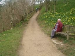 The second seat is just before the biggest slope along the path.