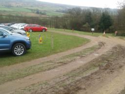 At busy times there is an overflow car park on grass  with blue badge  parking places near the entrance. grass