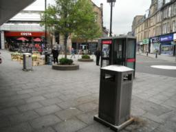 City centre amenities such as public telephones, litter bins, shelter under shop canopies.