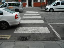 Zebra crossing by drop off point outside the station. Dropped kerbs on both sides of crossing.