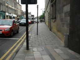 Leave the pedestrianised centre and continue along the pavement. Sign posts are on the pavement but still wide enough for mobility scooters to pass.