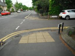 Dropped kerbs and tactile paving at crossing points.