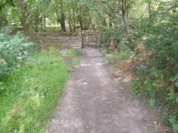 Path continues on hard, uneven surface down gradient of 1.12 (8.3%) for ten metres before next gate.