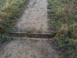 There are a number of similar drainage channels along path