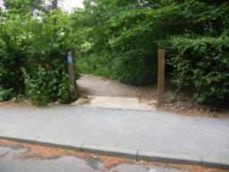Route joins pavement of New Rd (B6076)