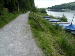 Route levels out on approach to sailing launch and clubhouse. Bench situated off main path.