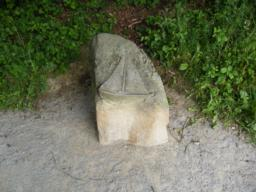 Stone carving, beside path - see sailing features
