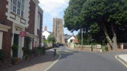 Just before a set of traffic lights, it is possible to turn right to visit Dunster castle.  The road bears right at the lights with a church set well back from the road.  The church of St George has occupied the site since the 12th Century.