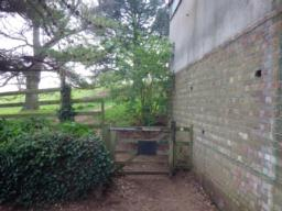 In the south-west corner of the car park, there is a gate (1m 20) which leads into the parkland around Dunster Castle.