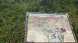 An information board explains the history of the Iron Age structure.