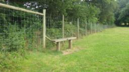 The trail now crosses wood parkland.  A seat close to the gate gives a good view of this and beyond to Dunster Castle.