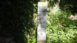 Close to the ruins, there is a board displaying QR codes for poems by local school children.
