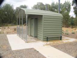 Toilets, including and accessible cubicle are located by the car park