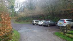 The car park is 100m to the north of the B3223, between the church and the Exmoor Forest Inn.