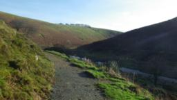 Having passed through the gate, the trail heads down the hill (18%) with the river coming into view again on the right.