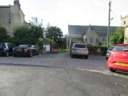 Car park and pedestrian access from the village green. A level 1m wide paved routes leads from the road through the parking area to St. Mary's churchyard.  No spaces are designated for disabled visitors. Car park surface is compacted gravel but there are also some areas of loose gravel. Parking bays are not marked