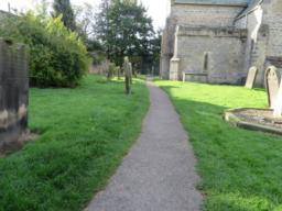 Route through the churchyard is narrow, 1m wide and surfaced.