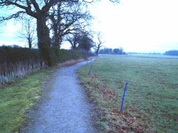 The path is wide enough for two people to walk side by side over most of its length. There may be an electric fence next to the path when sheep or cattle are grazing.