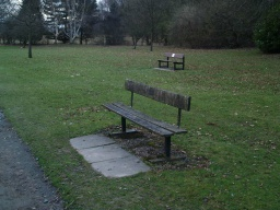 Seats are provided close to the path and on the surrounding grass.