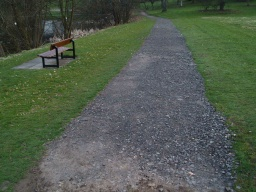 A seat near the loch but a little way from the path. The surface is again made up of coarse loose stones.