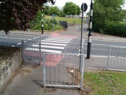 The barriers by the pedestrian crossing have gaps more than 1m wide.Cross Parkhead Road to continue along the Devon Way