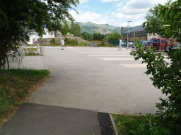 Cross the open area in front of the Health Centre to continue to the path on the other side