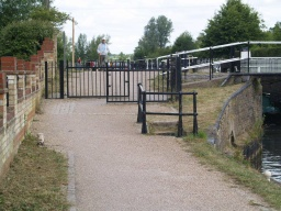 There is a chicane formed by two gates with about a 1m gap  on the slope adjacent to Stanstead Lock.