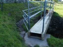 A bridge with a 300mm step to it must be crossed or a narrow path fooled in order to cross the inlet.