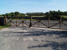 Locked gates prevent vehicular or pedestrian access from the B5282 to the Bittern Centre.