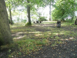 Some picnic benches along the banks are accessed over rough ground.