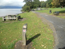 At this point, visitors have the option to continue along the Shore Walk, providing a linear walk or a longer circular walk. Just past the Slipway is a yellow and red  arrow on a waymark post. Turn right here to re-join the Southern Route and follow the path up the hill. This is a more direct circular walk to the Castle.