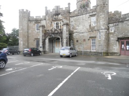 There are several diasabled parking bays at the entrance to the Castle, although these do not have a cross-hatched zone.