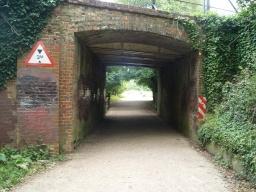 Go ahead under the railway bridge.