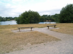 There are several seats at the end of the lake which is the furthest point from the start.
