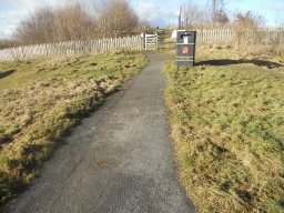 A short path on a minor incline leads from the car park to the site entrance.