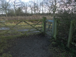Another double set of gates appears before the Church. As before, the field-gate has been padlocked. The wicket gate, however, is hinged so that it opens in both directions which is easier for wheelchair users to operate.