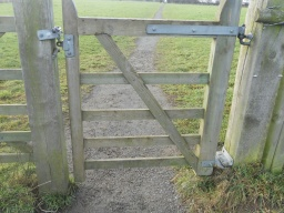 There is narrow clearance through the wicket-gate. The gate is hinged so that it opens in both directions, which makes it more accessible to wheelchair users.
