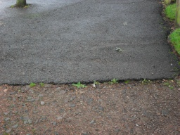 There is a lip onto the path ramp at the right hand side but the left hand side is even
