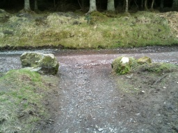 Turn right and the car park is 150m away.The is a boulder at the junction which may provide a seat.