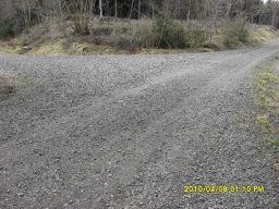This is  a short section (30m) of forest road covered with large loose stones.