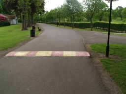 The speed bumps have a gentle slope on and off but no space to pass at the side without going onto the grass.At the path junction keep left towards Callendar House.