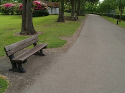 There are 11 seats or places to sit and rest close to the path along this route. They are not even spaced with the longest gap between accessible seats being about 800m. There are other seats in the park some are across grass areas or down banks.This seat is 430mm high.