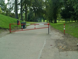 The trail starts at the red and white barrier into the park.